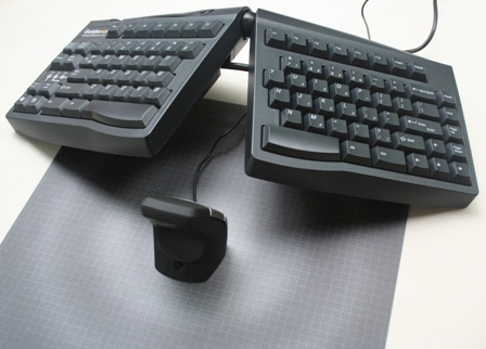 DXT Ergonomic Precision Mouse to the center of a Goldtouch Keyboard